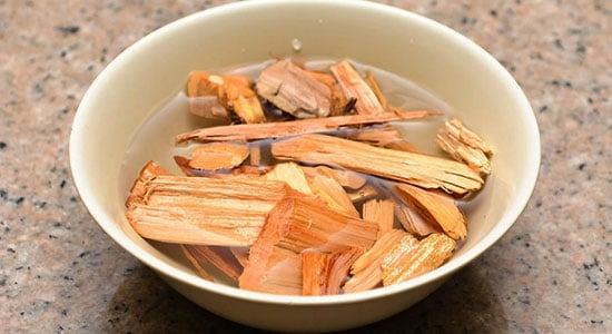 Place wood chips into a bowl filled with water