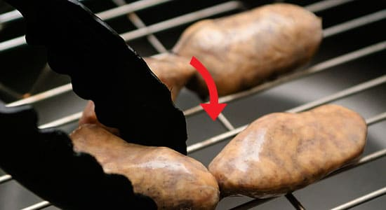 Place the dried sausage from cooking sticks or metal racks within the smokehouse